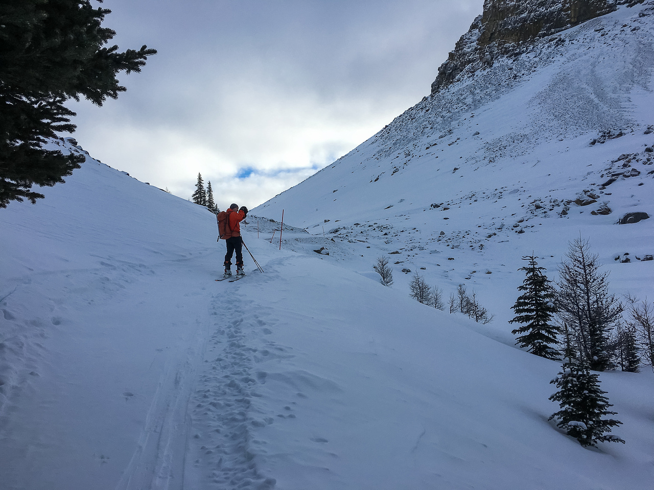 Mike skis up the final icy, wind blown section before Boulder Pass.