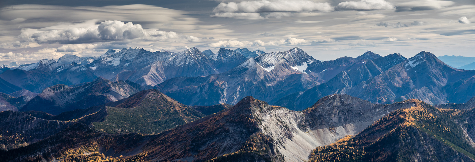 Unfamiliar, but fairly lofty, peaks to the south, likely many of them in Glacier National Park in the USA.