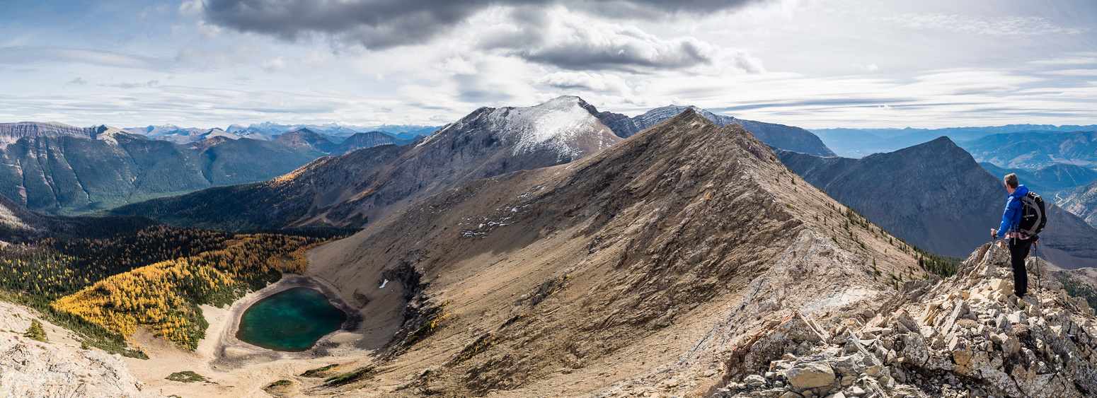 """Gorgeous views south over Rainy Lakes towards JSP. The peaks that we dubbed, """"Red Argillite"""" are left of Phil in the distance."""