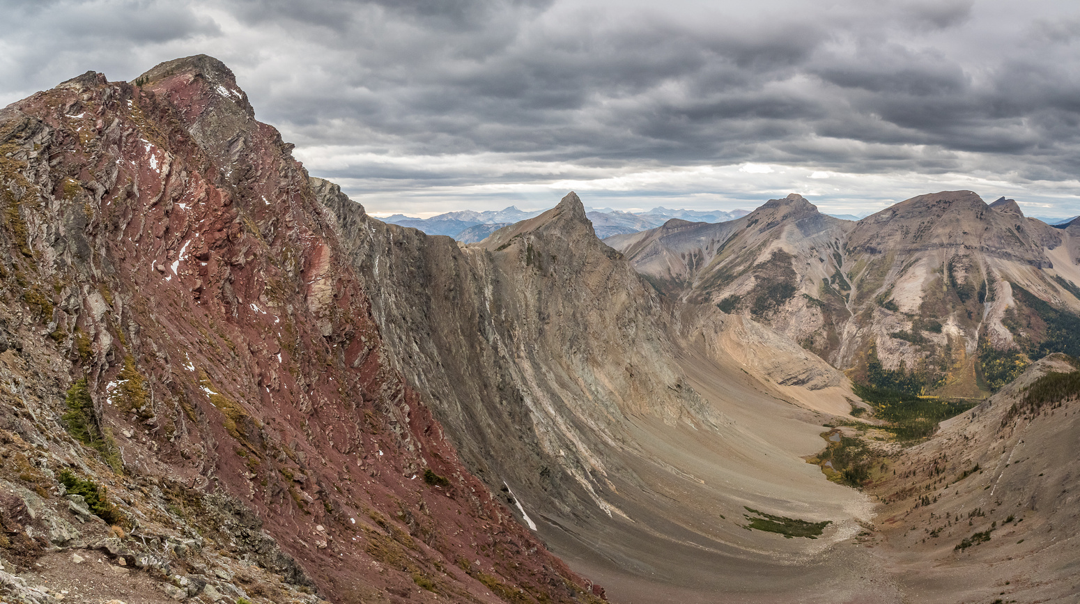 The two peaks of Red Argillite at left with Krowicki and Miles at right distance.