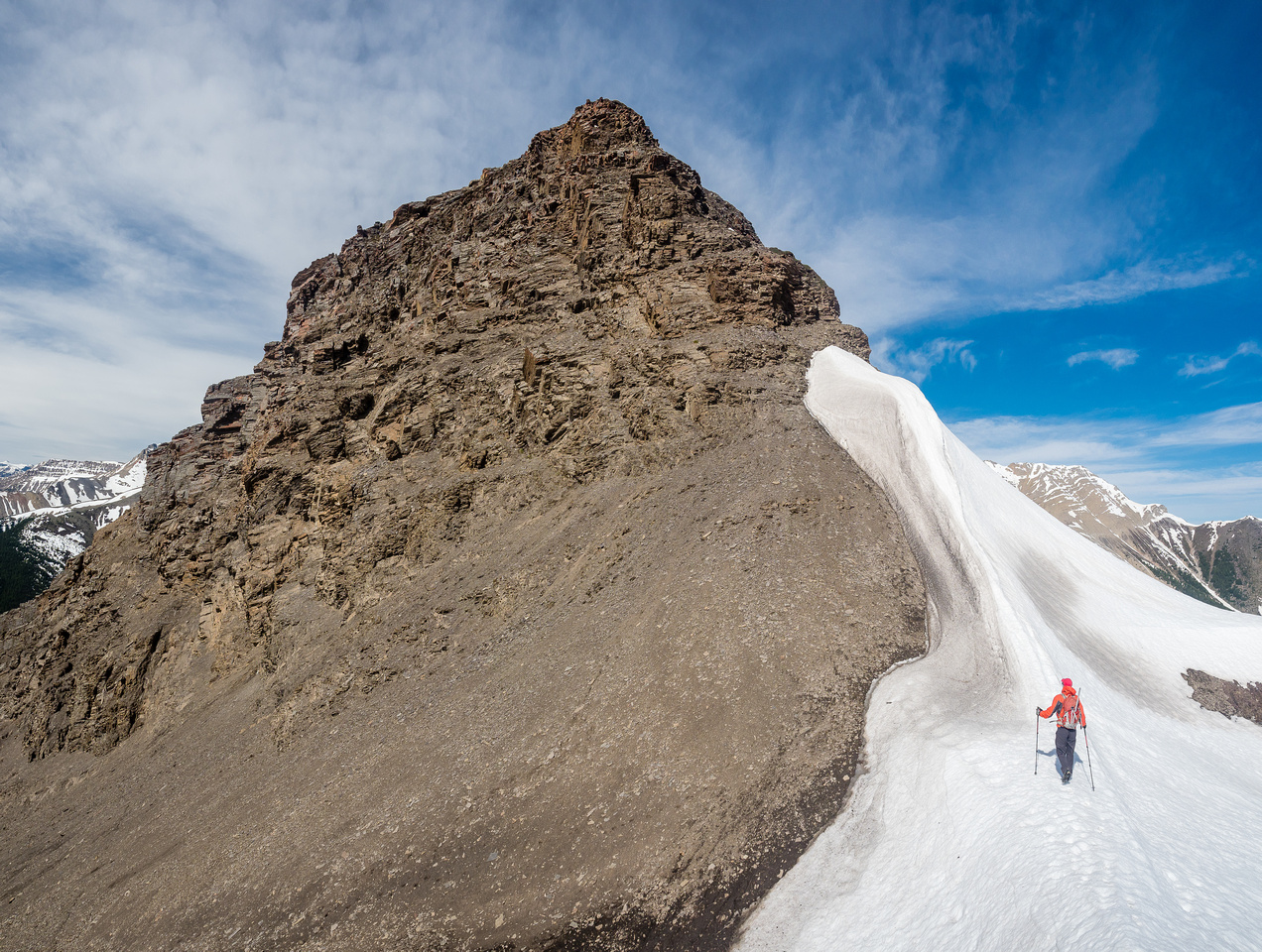 Mike traverses from the col between the two summits towards the summit of Ernest Ross.