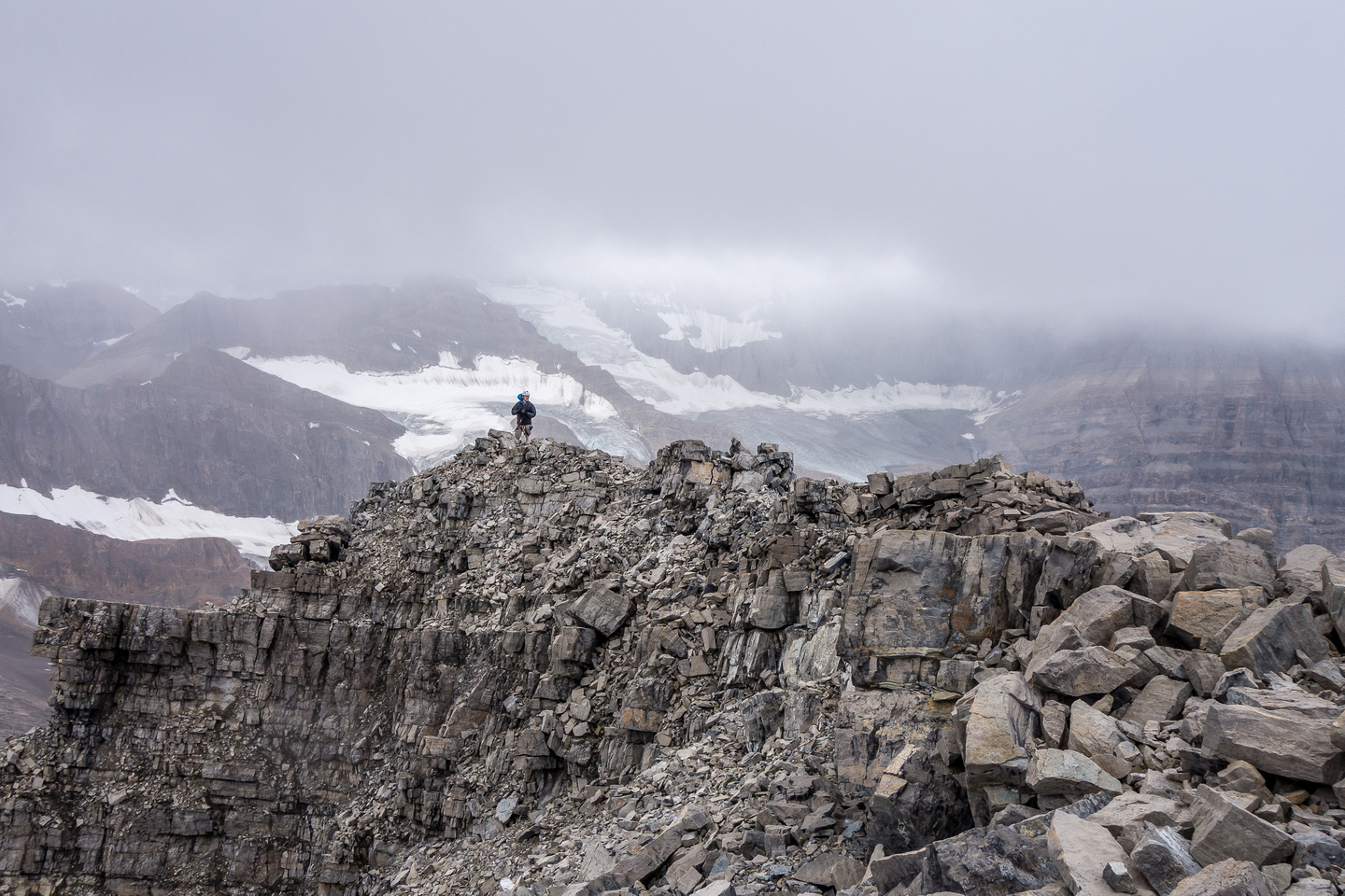 Ben takes in the wild scenery at the summit of Recondite Peak.