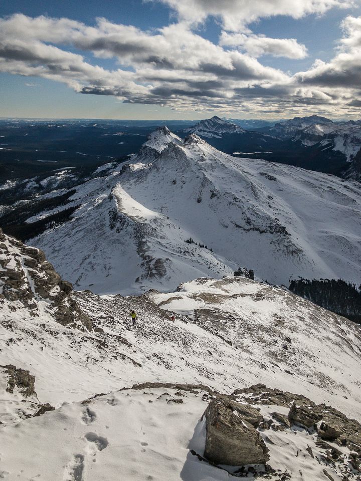 The cliffs are far below us now and Black Rock is showing up beyond the double (triple?) summits of Fallen Peak.