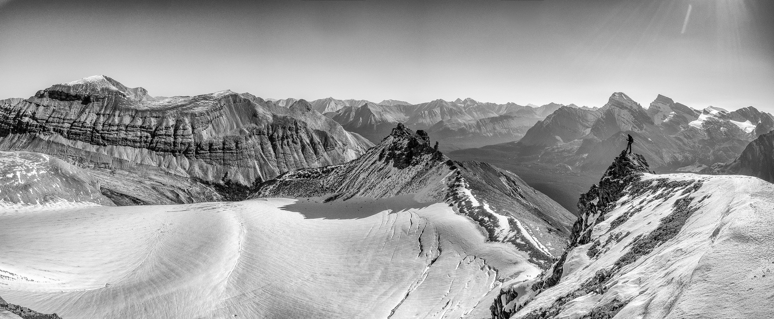 Phil enjoys great views over the Drummond Icefield towards Mount Drummond at left and the Pipestone Towers at center.