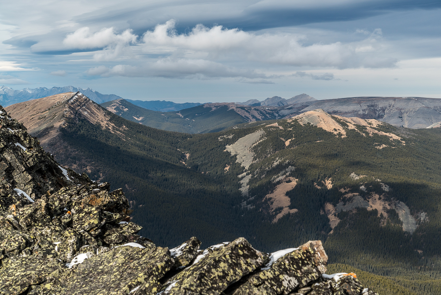 Looking over an outlier ridge of Pasque (L) towards Burke in the far distance over the shoulder of Plateau Mountain.