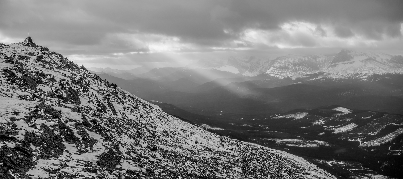 Dramatic lighting with the north summit cairn at upper left.