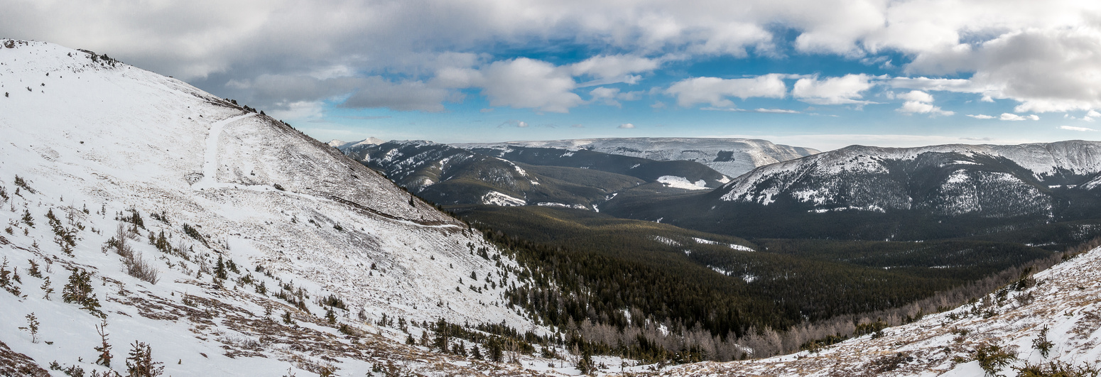 Looking back at our access road with Plateau in the distance at center and the east rib of Pasque's horseshoe at right.