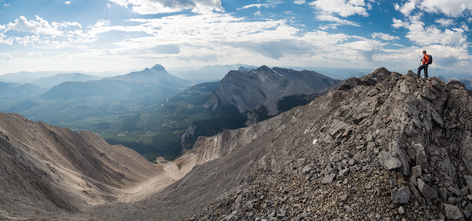 "Wietse stands on ""Pony"" Peak. The terrain at left is much steeper than it looks in this flattened panorama."
