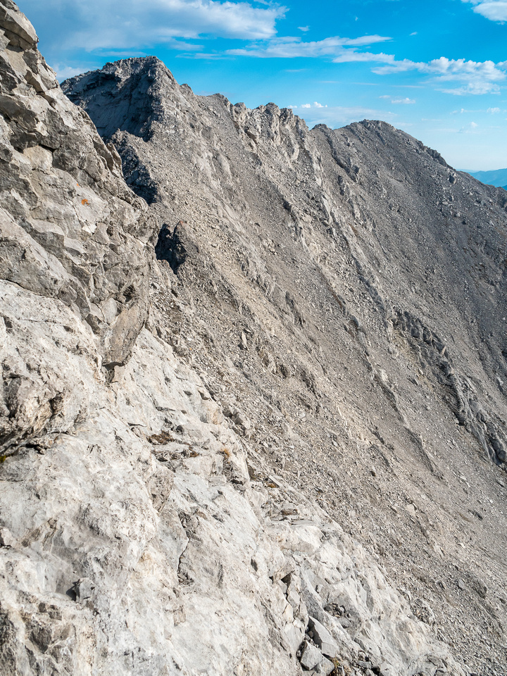 """Complicated terrain, trying to drop down to the col between """"Pony"""" and the high point."""