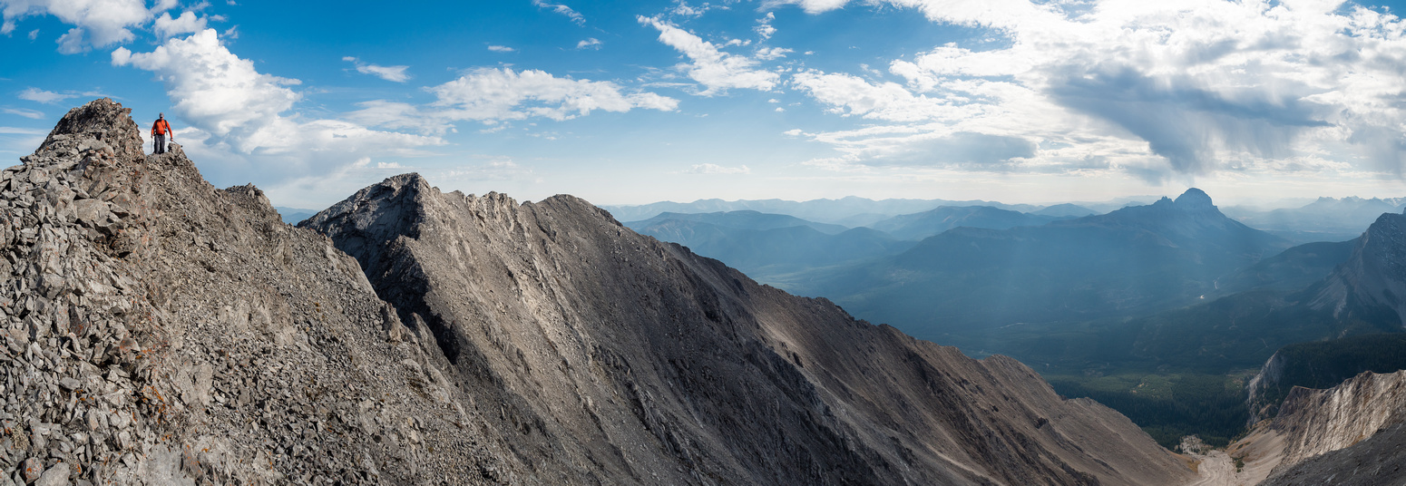 """Wietse comes back along the ridge from """"Pony"""" Peak with the highest point on the ridge behind him. Crowsnest Mountain at right."""