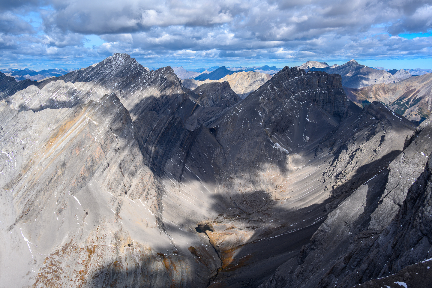 Views to the upper headwall lakes valley to Fortress Mountain. Galatea and Gusty at left.
