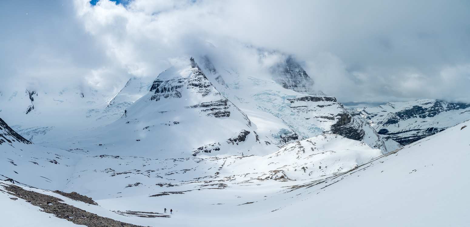 This is looking back at Waffl with The Helmet and Robson starting to show through the clouds and the Berg Glacier at right.