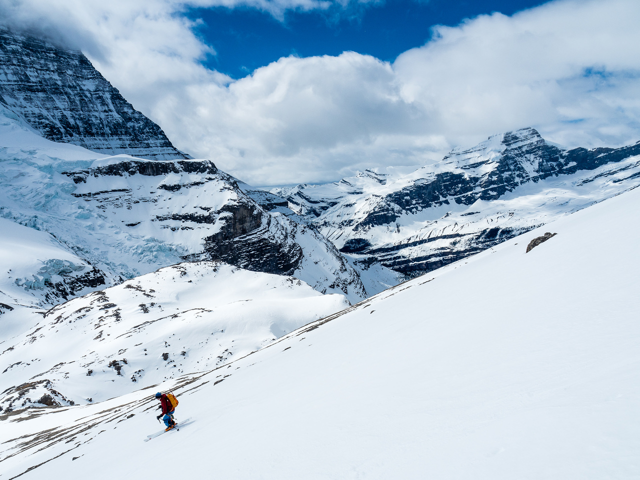 Ben skis down Rearguard's SW face with Whitehorn Mountain in the far distance and the upper Berg Glacier at left.
