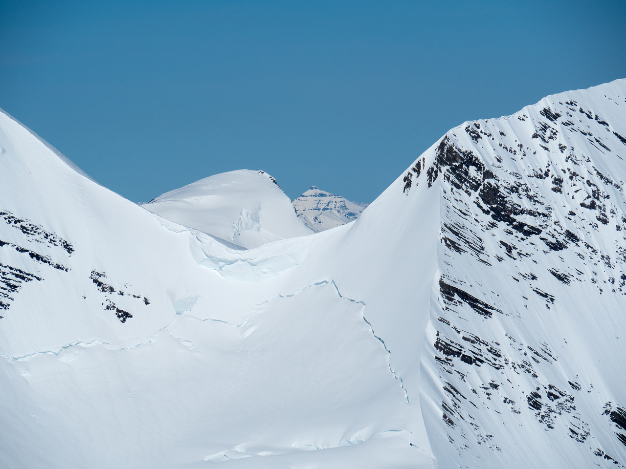"Mount Phillips (named after ""Donald 'Curly' Phillips"") shows up through the Robson / Helmet col."
