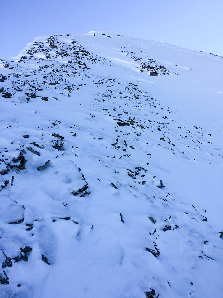 Scree covered snow made for slick conditions with the 'shoes on.