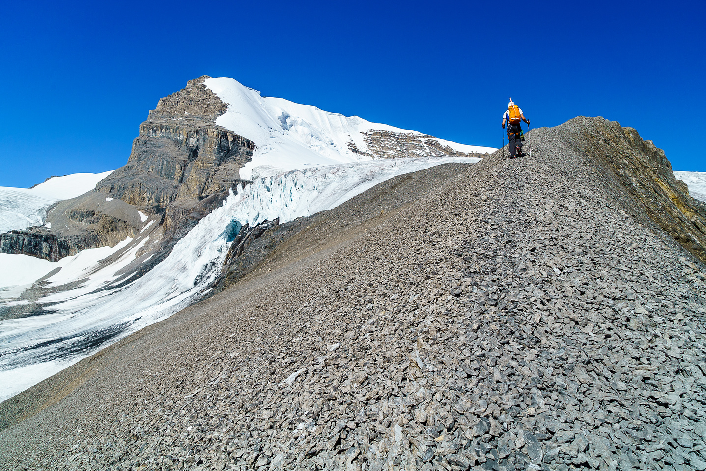 Ben makes his way up scree towards the glacial bench on Warren.