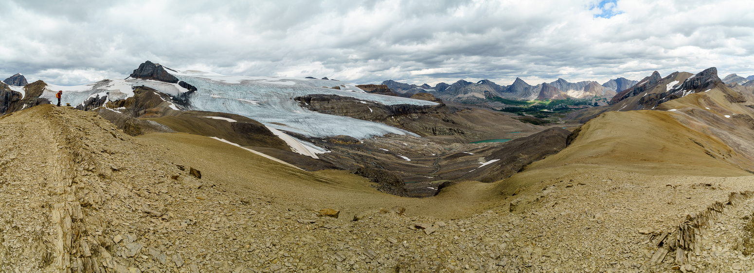 Gazing back at the Brazeau Icefield at left and Swan Pass at center.