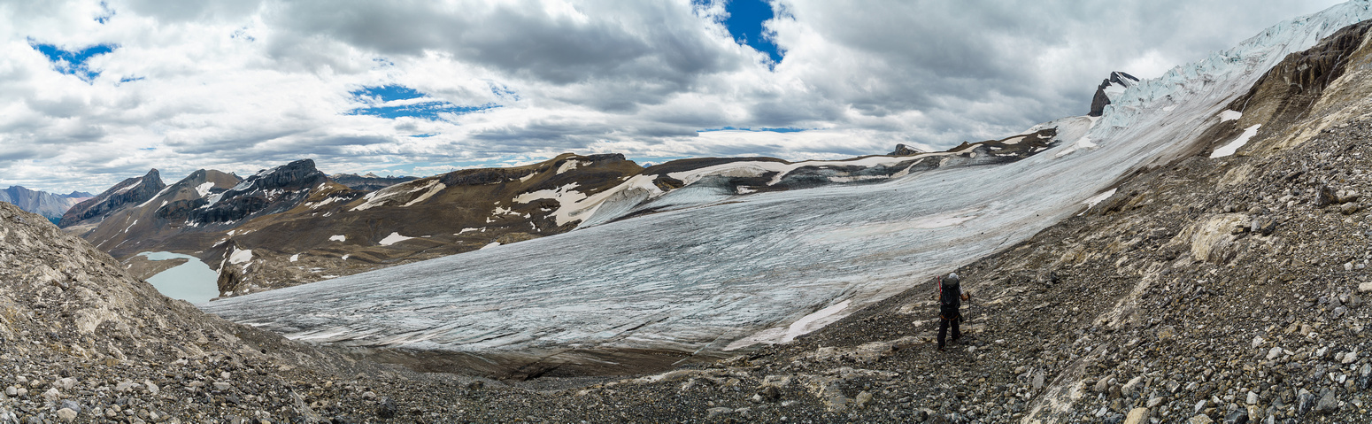 Ready to cross the lower glacier to the far moraine. The icefall to the right is the reason you must go up this rock.