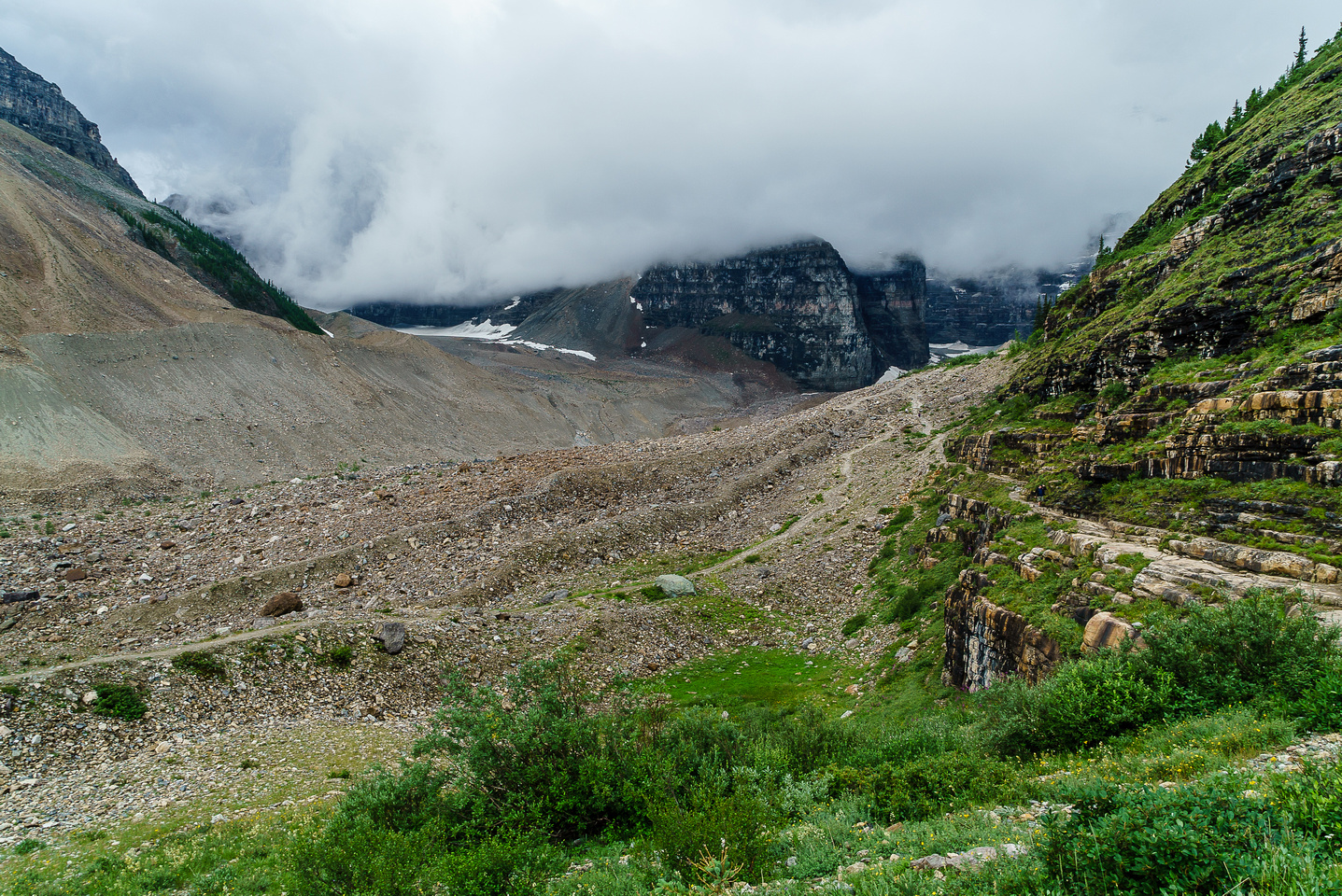 Low cloud hides the big peaks as we approach the cool ledge traverse on the main trail to the Plain of Six Glaciers tea house.