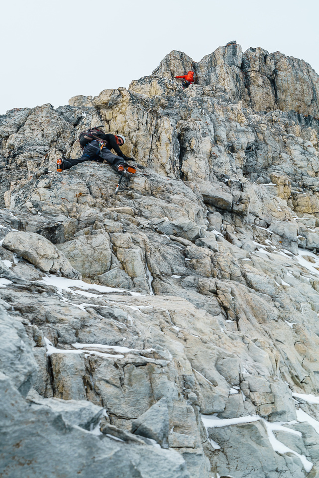 This terrain could easily justify another rappel and judging by the tat, more parties choose to go that route than solo downclimb it.