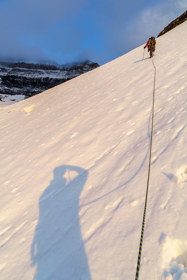 It's chilly, but the snow is already soft as we work our way high on climber's right above the main glacier.