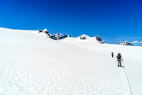 Rounding the south ridge of Christian now and descending to the main Lyell Icefield. The five Lyells all visible now.