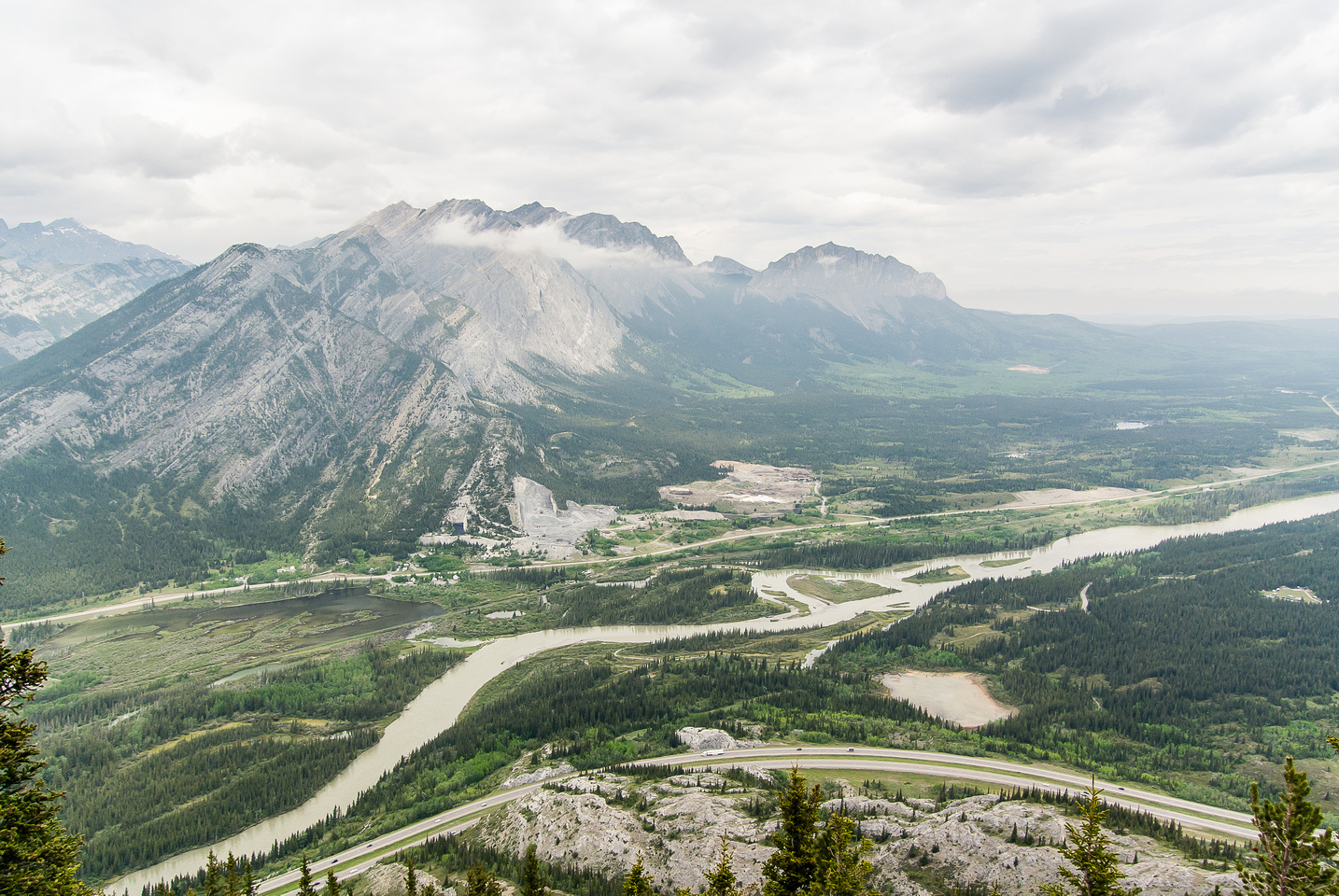 Looking north over the Trans Canada highway at the Goat Traverse which includes Door Jamb, Loder and Goat Mountain (L) and Yamnuska (C)