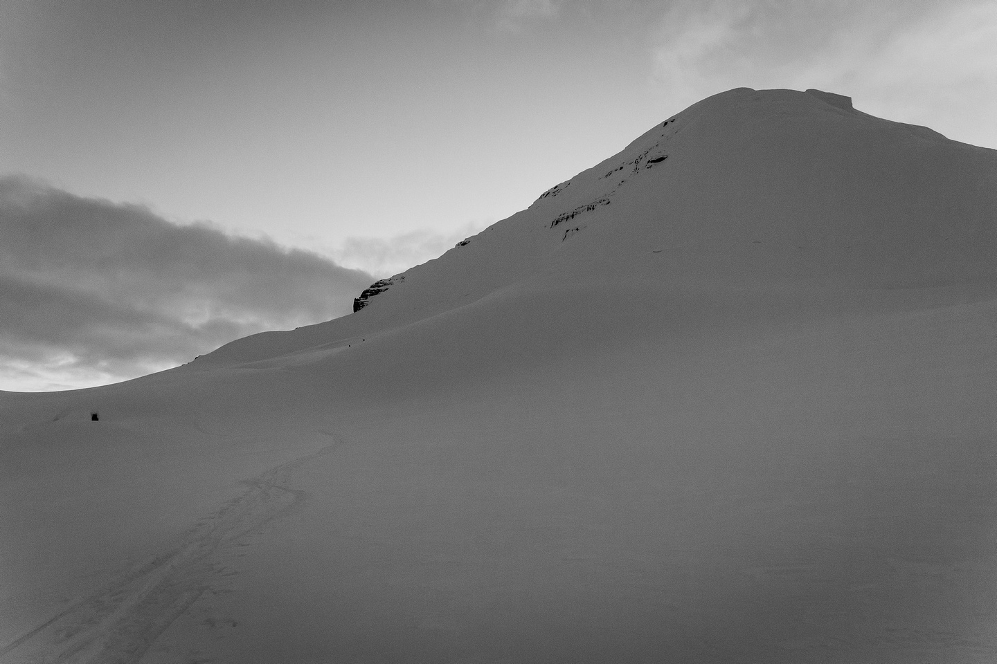 Looking back at Steven and Ben as they ski down from the east face of Columbia in fading light.
