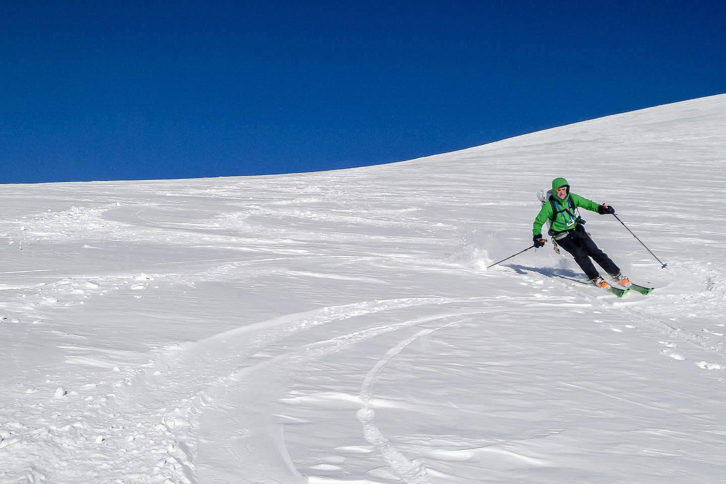 Vern skis down - what a blast!! Photo by Steven Song.