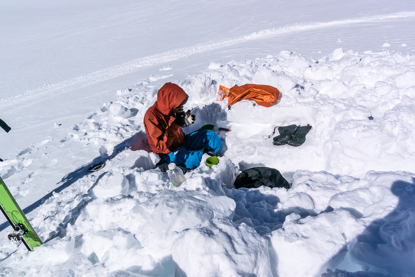 Ben enjoys a late lunch after ascending Snow Dome.