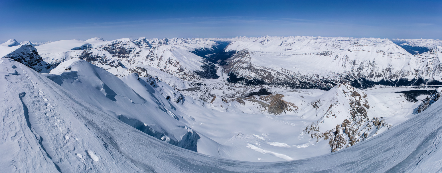 A steep pano looking off the summit of Athabasca over Boundary Peak, down the North Glacier to the Icefields Center and Mount Wilcox