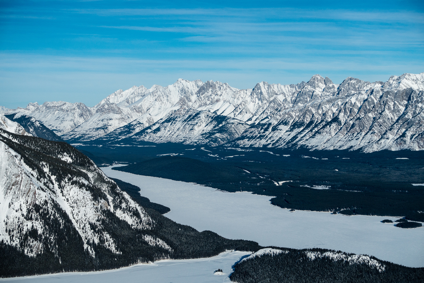 Looking over Lower Kananaskis Lake towards the Opal Range including Packenham, Hood, Brock, Blane and others.