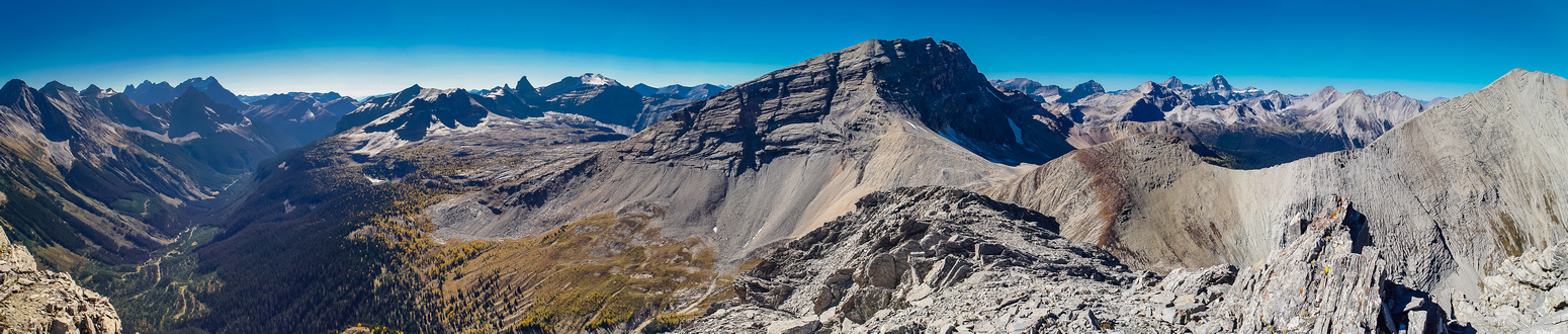 Pano from the false summit showing the Royal Group in the distance at left, Sharkfin, Solderholm, White Man, Alcantara, Aye, Assiniboine and Vavasour
