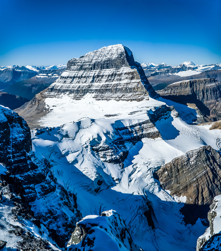 """A rare view into the depths beneath Mount Alberta's NE ridge and North Face reveals a very steep glacier, plunging into another """"Black Hole"""""""