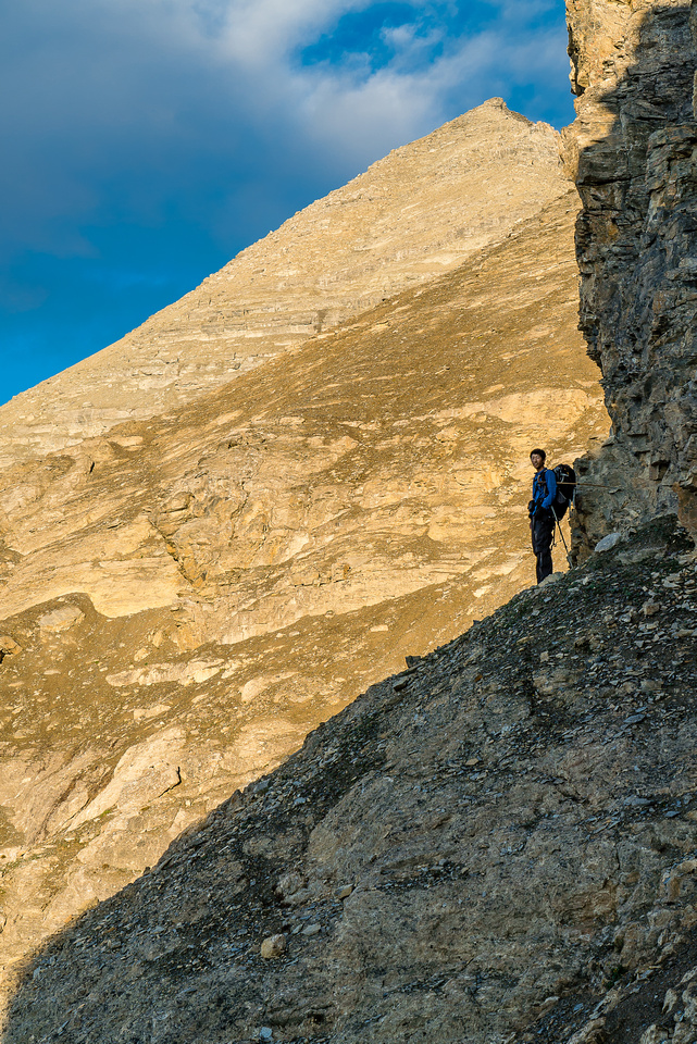 Steven waits for us under the false summit on the traverse.