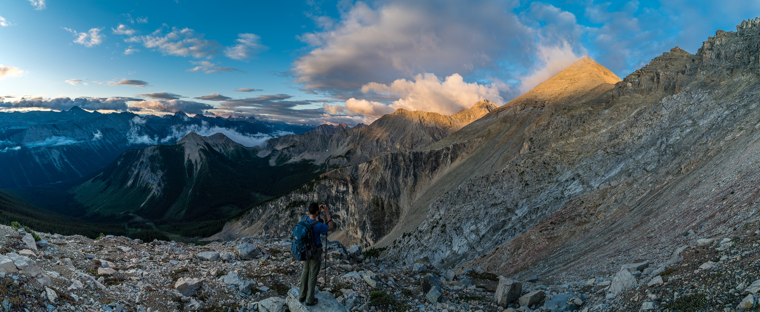 A pano looking left (south) as we go around the false summit - the true summit in the sun light ahead, right of center.