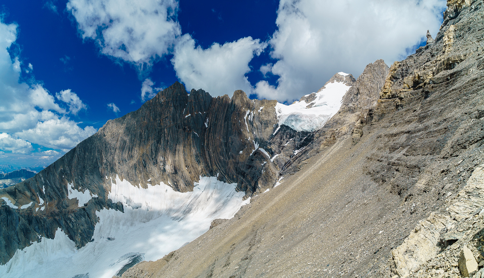 Looking back along the scree traverse from where we started the SW face ascent. King George visible in the distance.