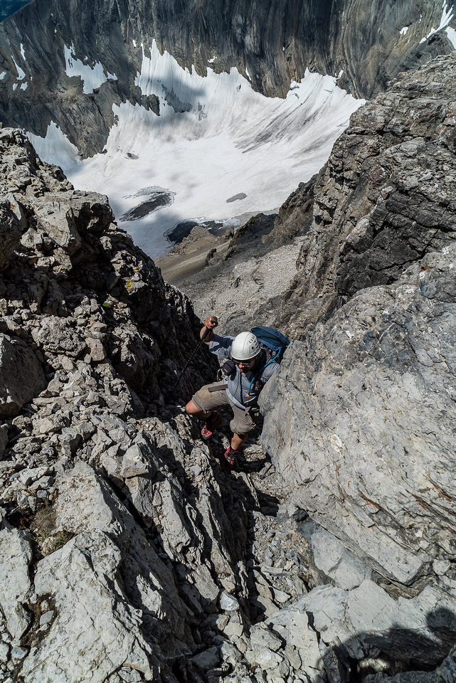 Eric negotiates a steep chimney just before the summit block.