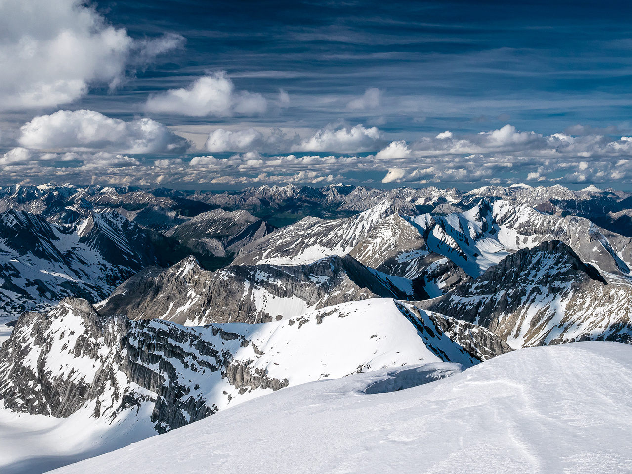 Looking north off the summit over the false summit towards Foch, Sarrail, Marlborough and many other Kananaskis Peaks