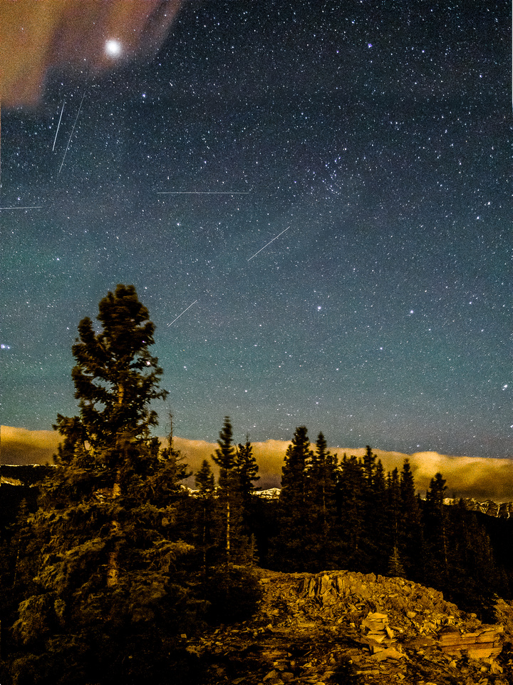 A composite of two shots showing a total of around 6 meteors - and Mars.