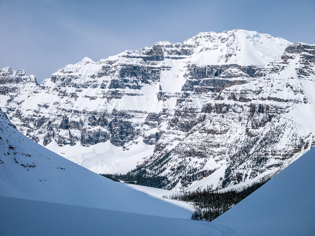 Looking back at Mount Lefroy as it sheds snow down it's steep east face.