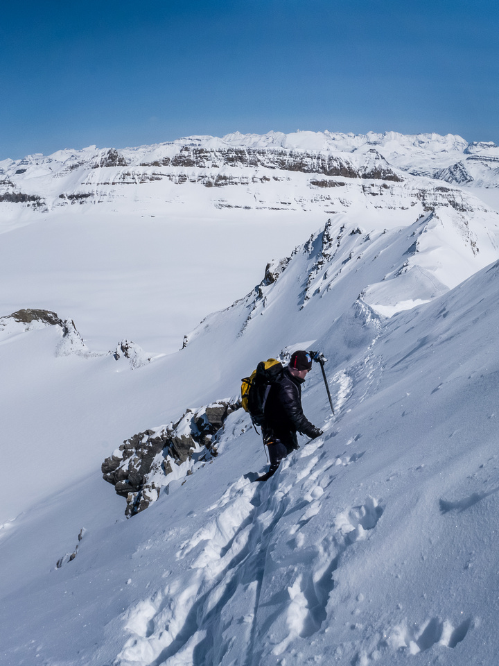 Carefully negotiating avalanche slopes and cornices at the same time.