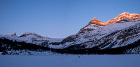 Crossing Bow Lake with sunrise on Portal and Thompson Peak at right. St. Nicholas and The Onion at left still in shadow.