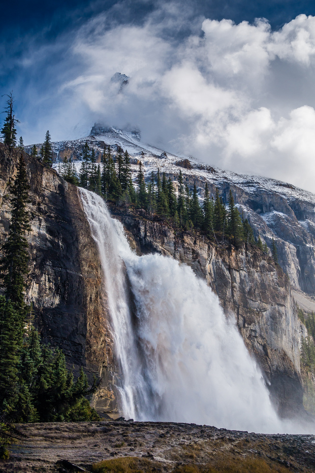An amazing scene of power and beauty. Emperor Falls with the lower part of Robson's Emperor Ridge towering in the swirling clouds above.