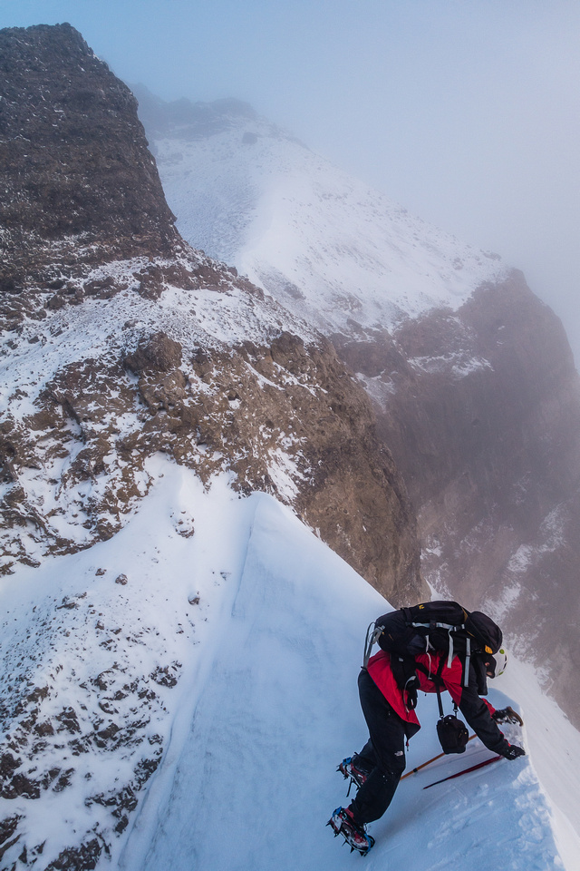 OK - this is no longer a 'simple scree hike'! With hard snow, glacier ice and fresh snow to spice up the rock, the south ridge didn't give up easily.