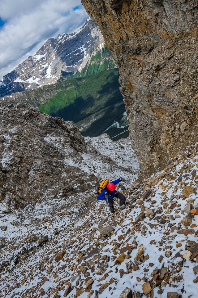 Wietse comes up to the buttress area after topping out of the steep final gully.