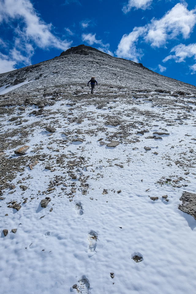 Heading up the final scree cone to the summit.