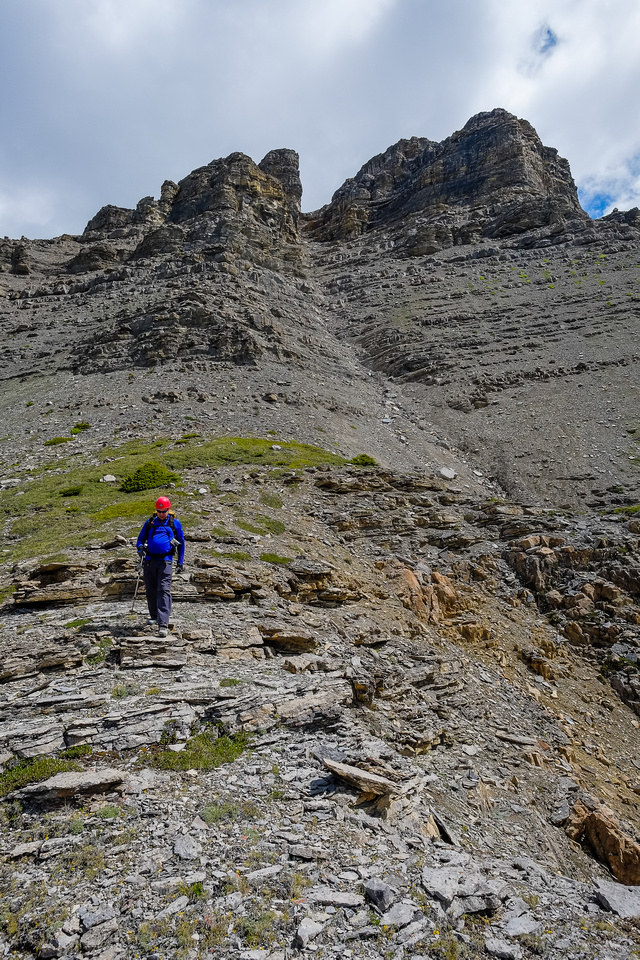 Looking back up at the buttresses and the upper access gully from the shoulder before going down the ledges.