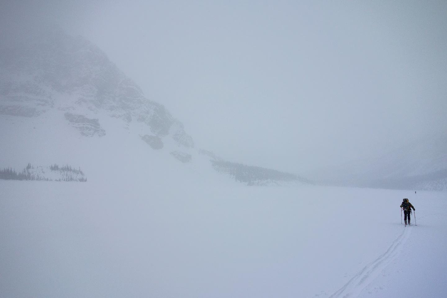 Skiing across Bow Lake in a white-out