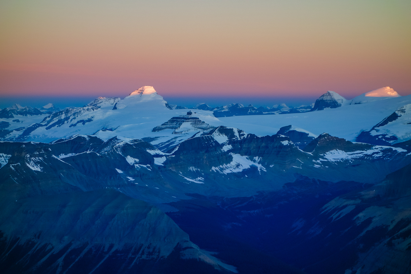 Mount Columbia and the Twins catch first light.